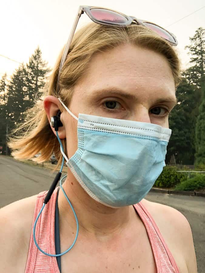 a woman working out while wearing a mask