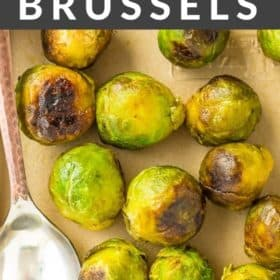 roasted brussels sprouts on a cooking tray with a spoon