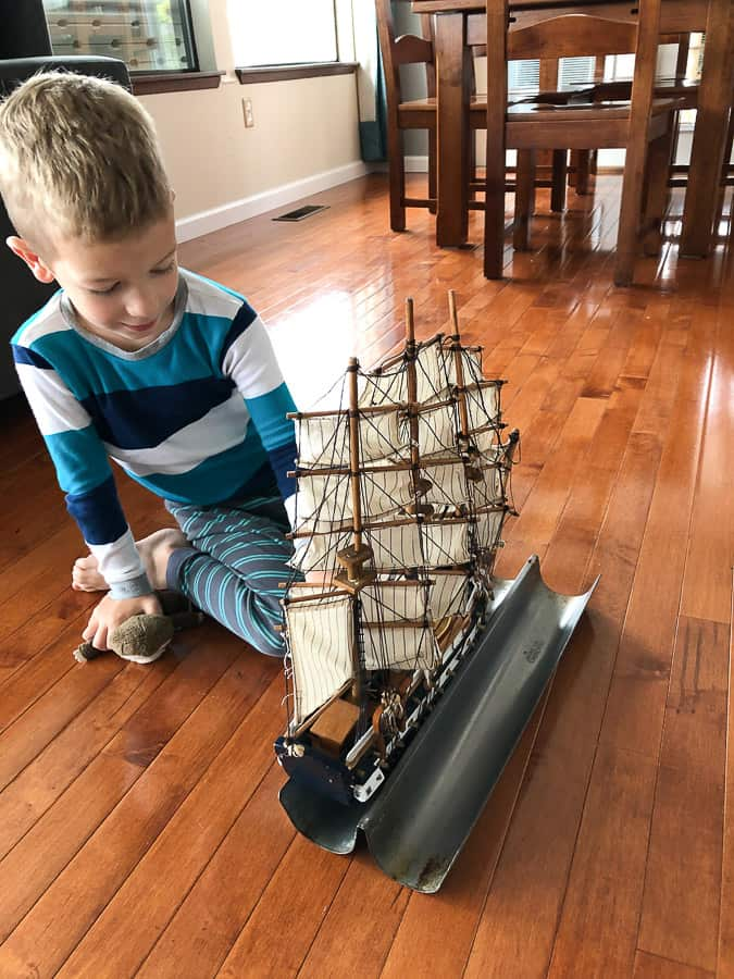 a boy with a pirate ship