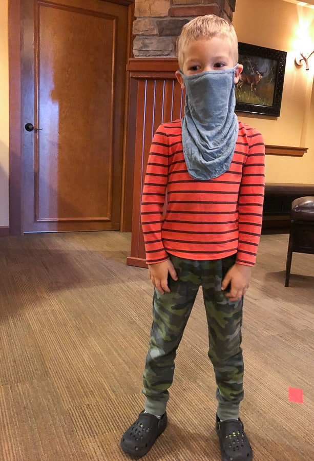 a boy in silly clothes with a mask