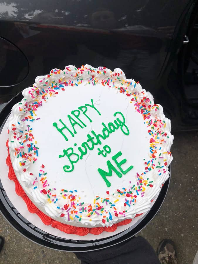 an ice cream birthday cake with green icing