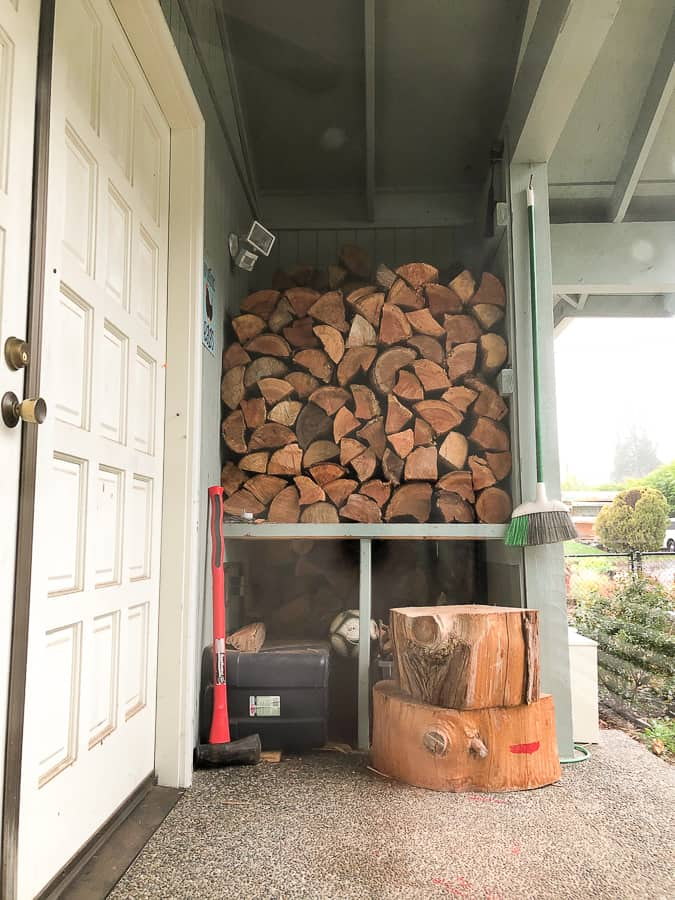 a stack of firewood on a porch