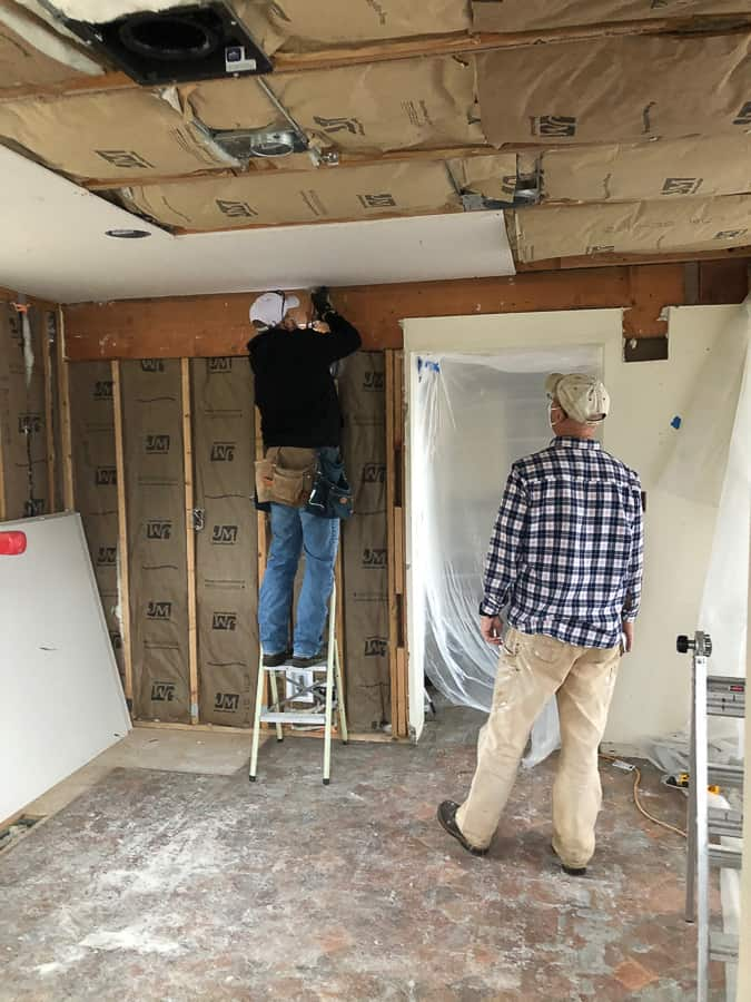 2 men hanging drywall