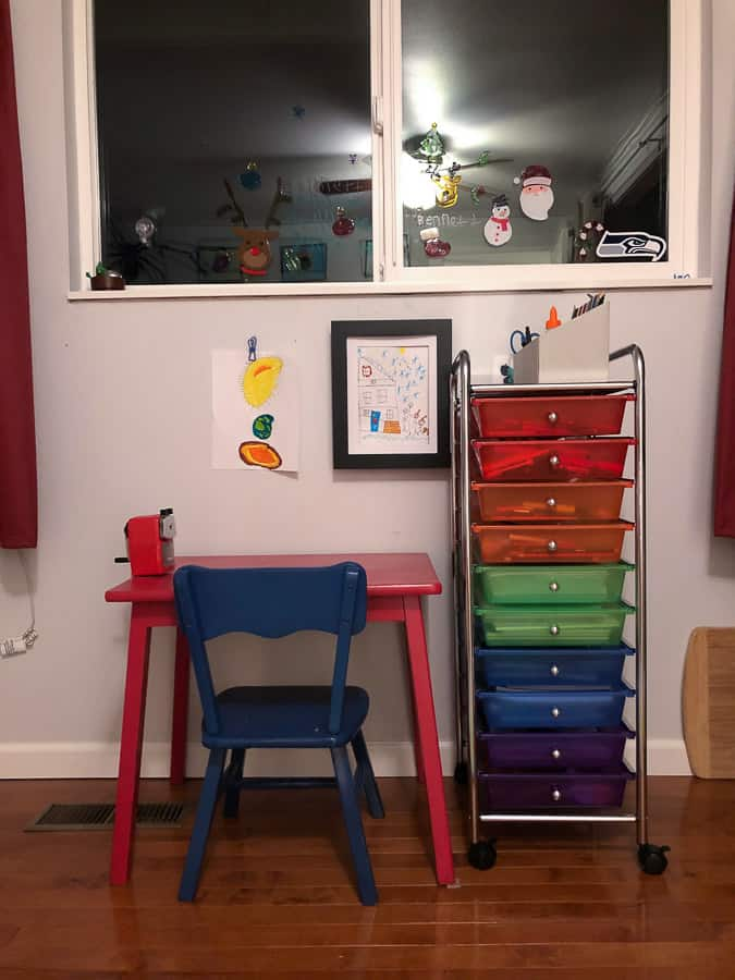 a rainbow cart in a kid's room