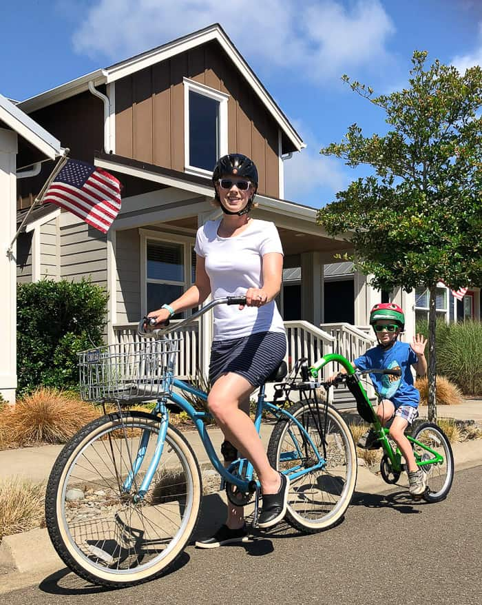 A mom and her son on a Burley trailercycle