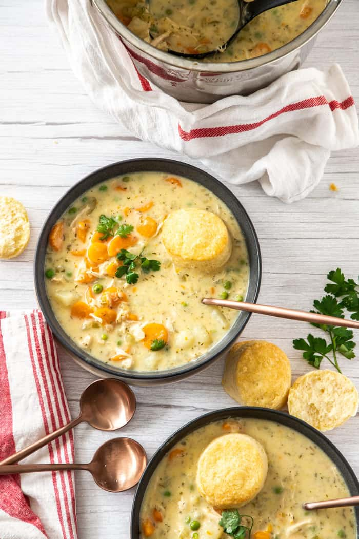 2 bowls of chicken pot pie with biscuits and herbs