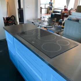 a stovetop in a kitchen island