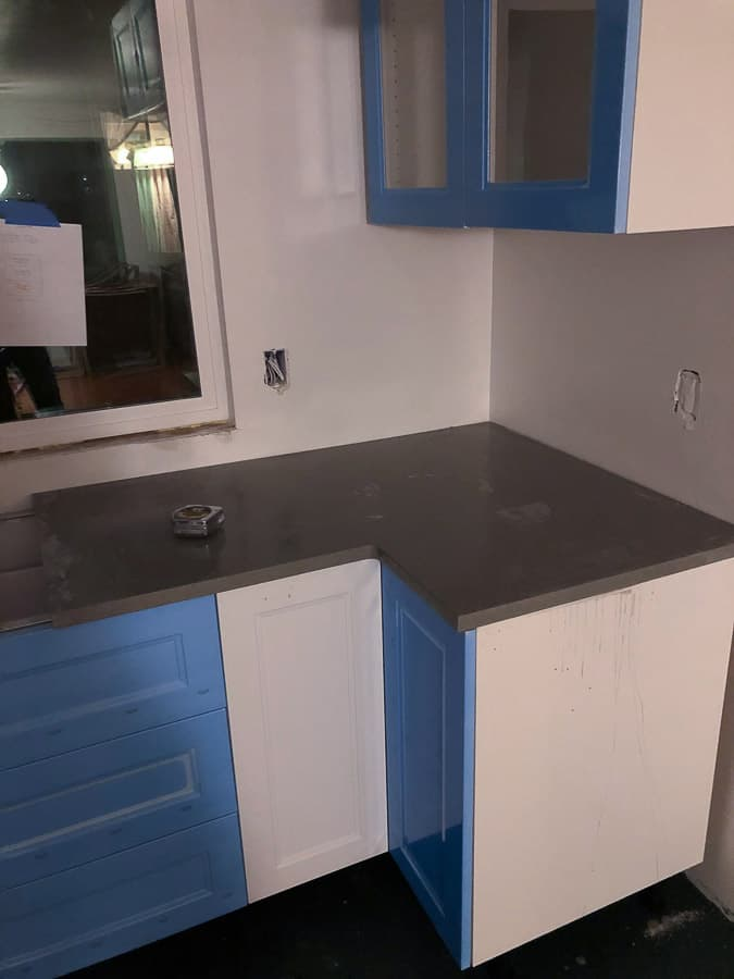 a kitchen countertop being installed