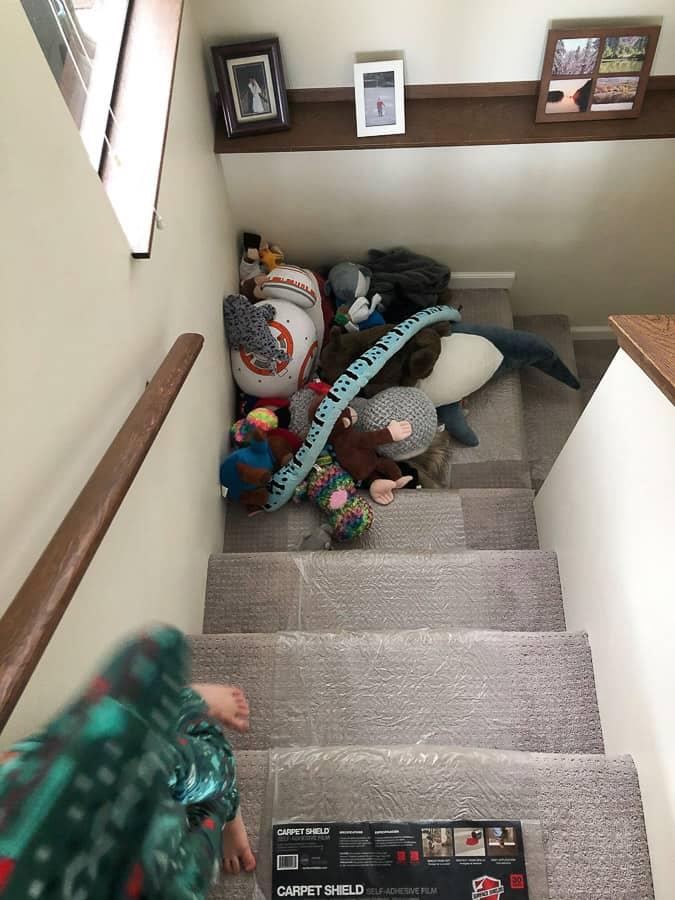 stuffed animals blocking stairs