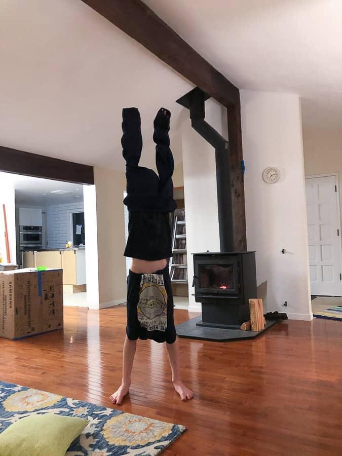 a boy wearing clothes backwards
