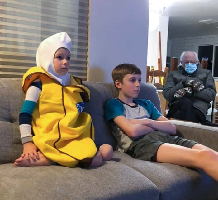2 boys on a couch, 1 in a banana costume