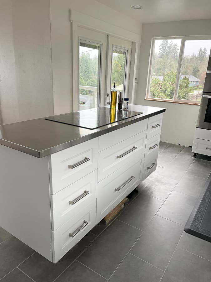 a kitchen island with a stainless steel counter