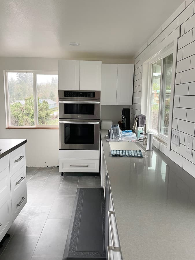 a wall oven and cabinets in a kitchen