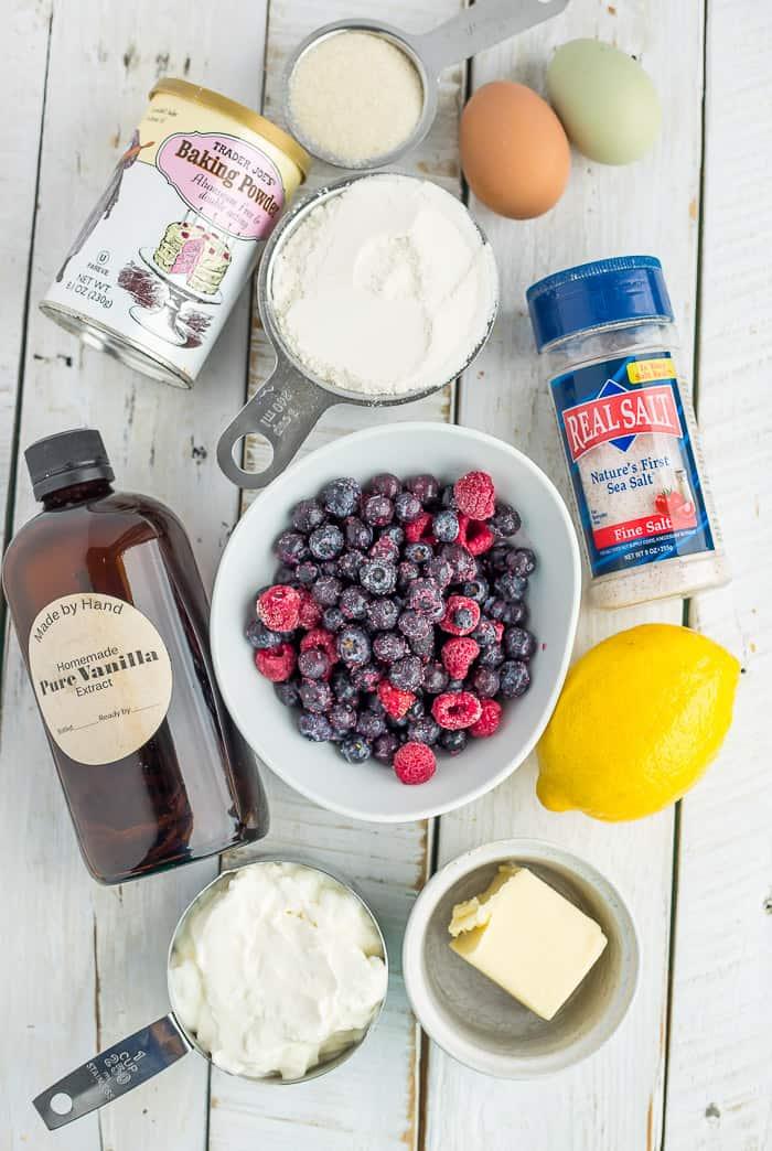ingredients for frozen blueberry breakfast cake on a white board
