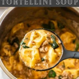 A ladle scooping Tortellini Soup
