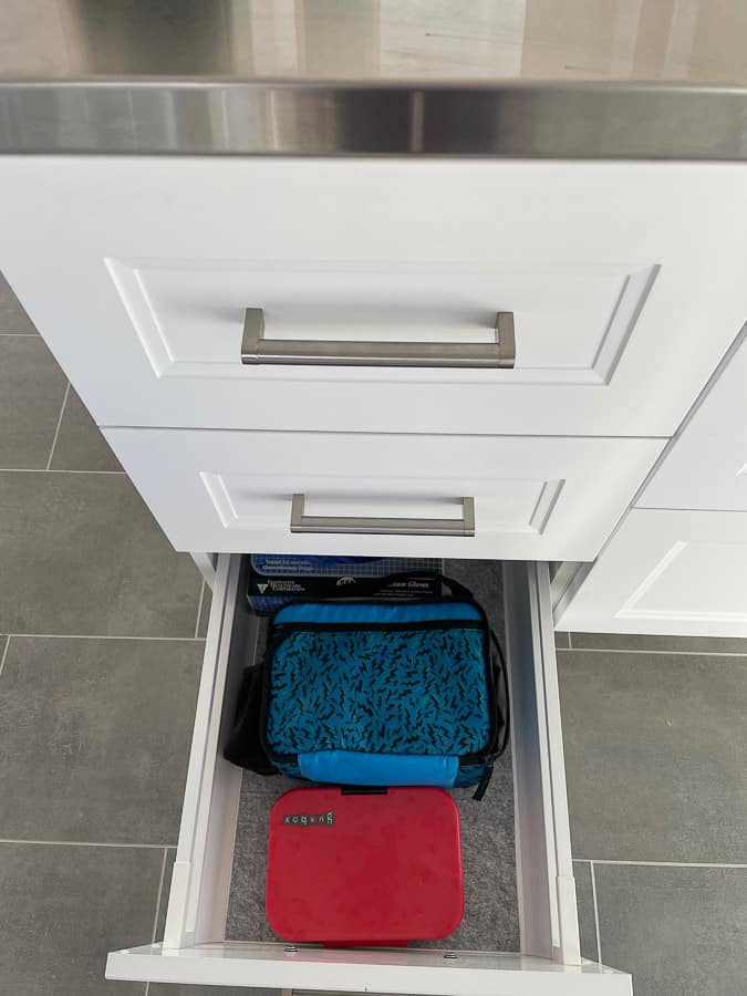 lunch boxes in a drawer