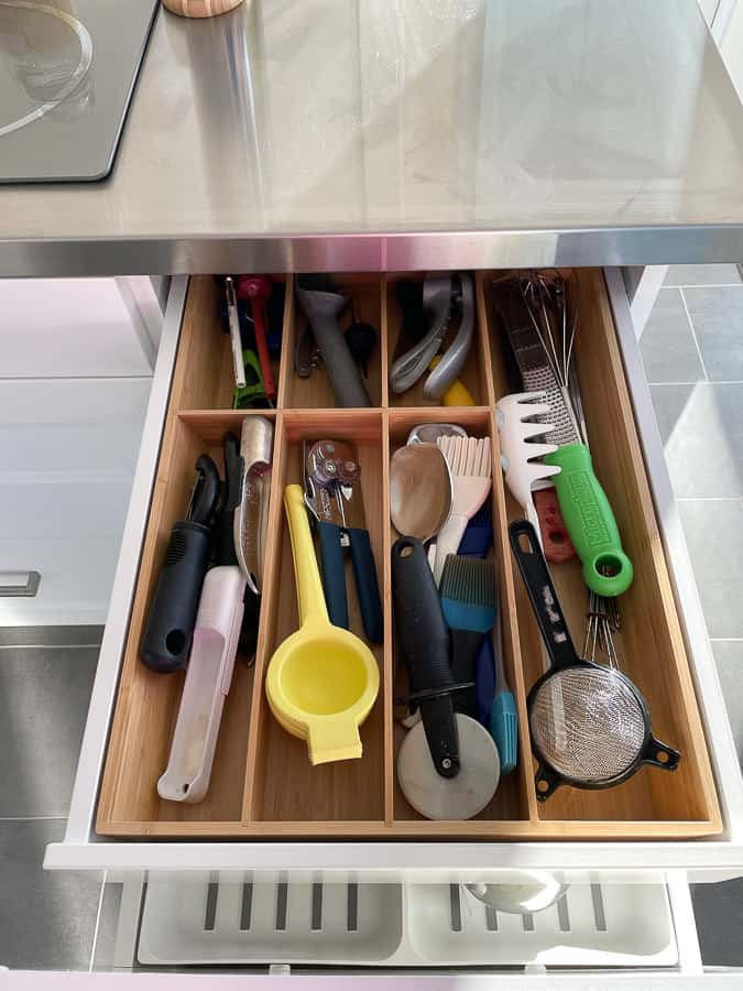 an organized kitchen drawer with utensils
