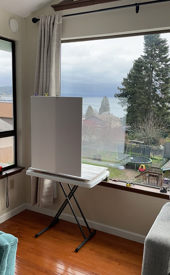 a folding table in front of a window