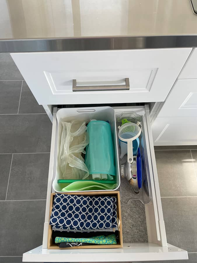 cloth napkins in a drawer with other bins