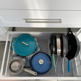 pots and pans in a kitchen drawer