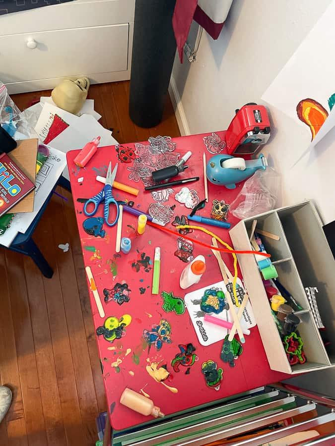 a messy art table