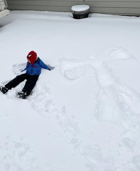 a kid making snow angels