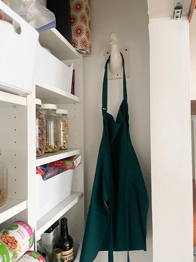 aprons hanging up in a pantry