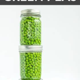 3 jars of green peas on a white board with a bowl of peas