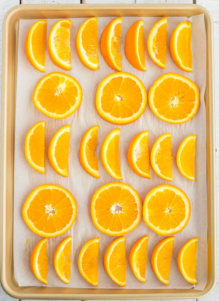 Frozen orange slices on a baking sheet