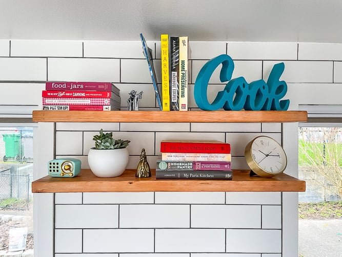 wooden shelves on a kitchen wall