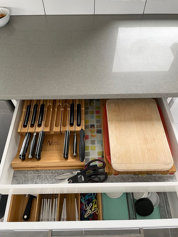 knives and cutting boards in drawers