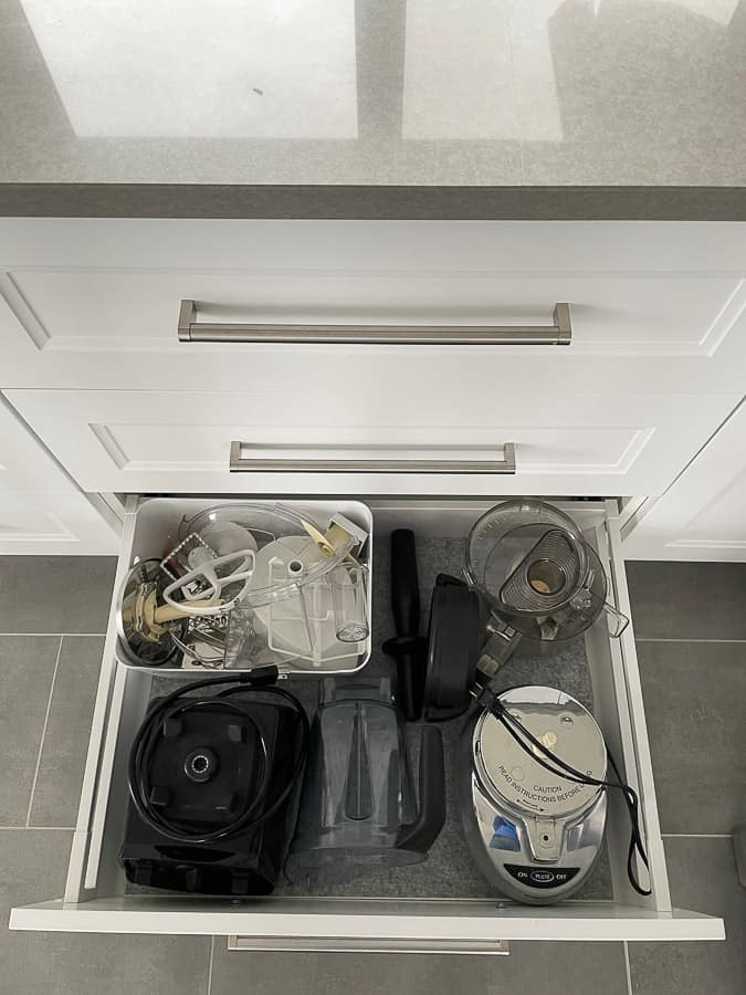 a blender and food processor in a kitchen drawer
