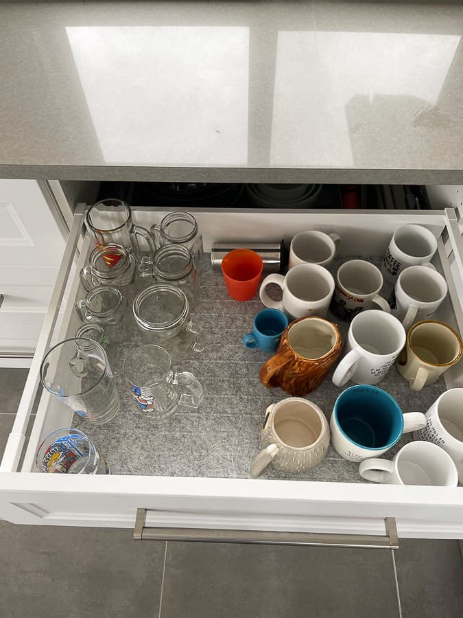 glasses and mugs in a drawer