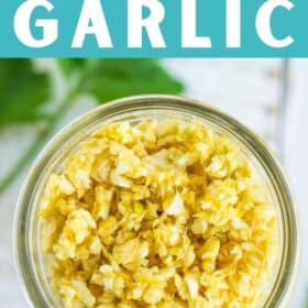 a canning jar of dried garlic on a white board