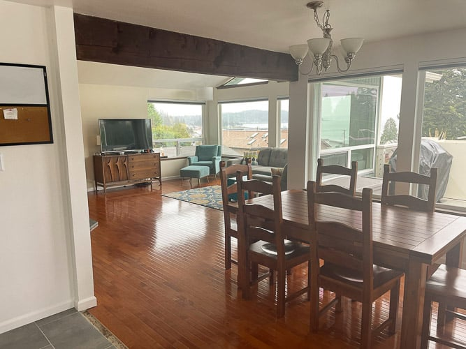 a livingroom and diningroom with wood floors