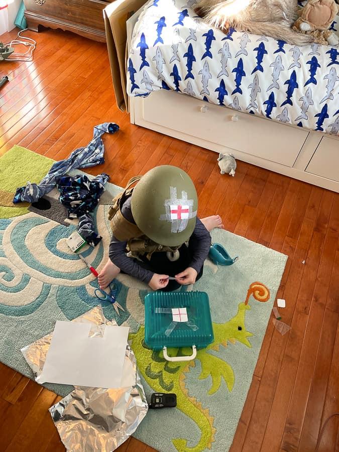 a boy in an army helmet