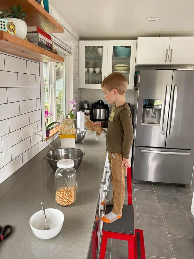 a boy making popcorn