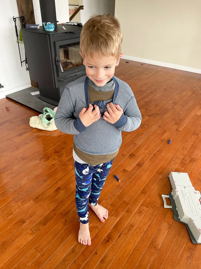 a boy wearing mulitple shirts