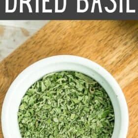 a white dish of homemade dried basil