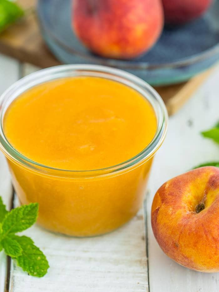 a weck jar full of homemade peach sauce