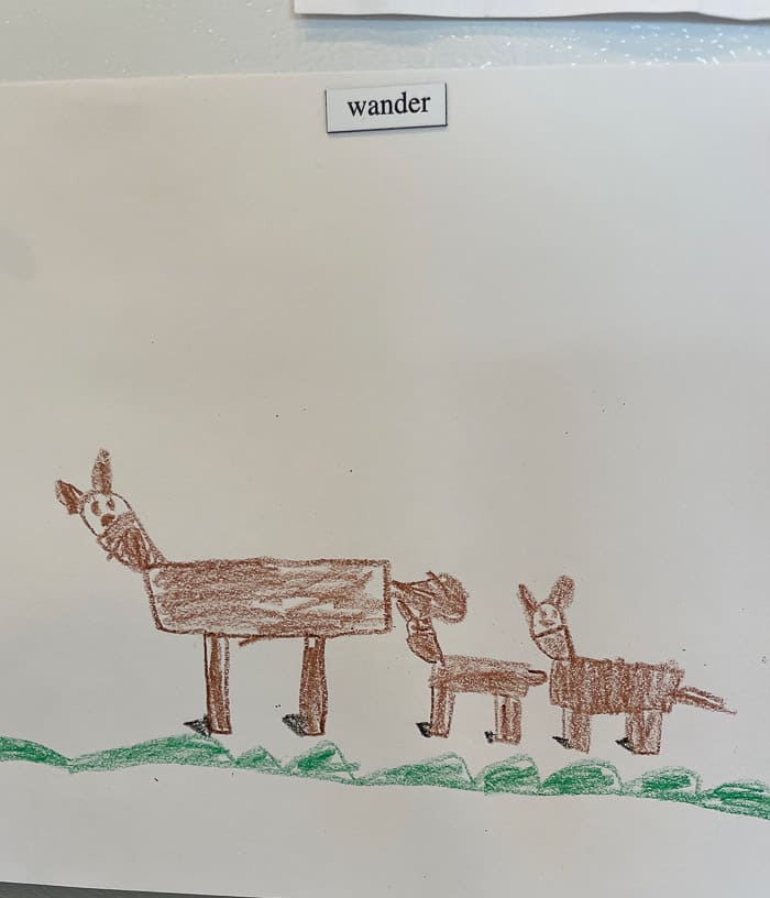 a kid's drawing of a momma deer with 2 babies