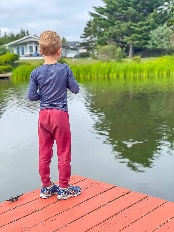 a boy fishing off a dock