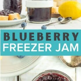 a close up photo of a glass jar of blueberry freezer jam on a white board with a spoon