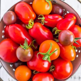 a white strainer full of tomatoes