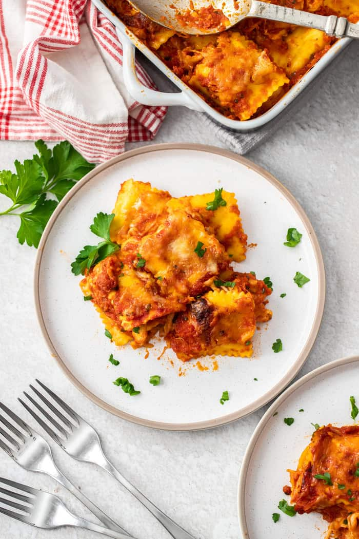 a plate of baked ravioli topped with herbs