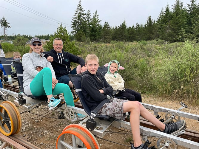 4 people on a railcar