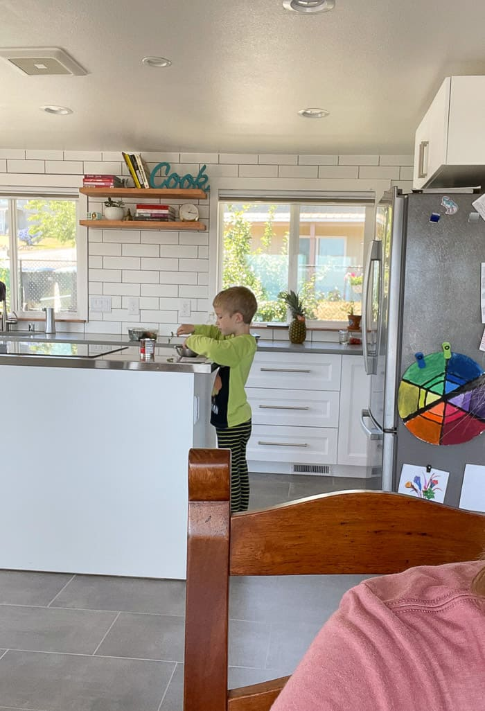 a boy cooking in a kitchen