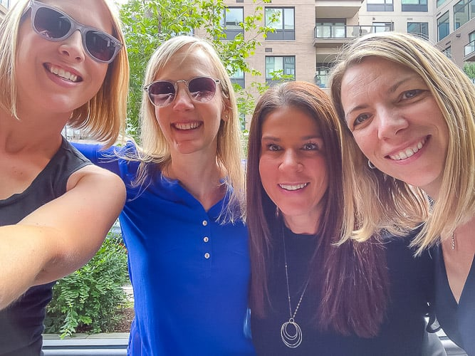 4 women smiling in a group pic