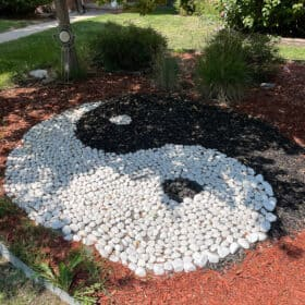 a yin yang made out of rocks