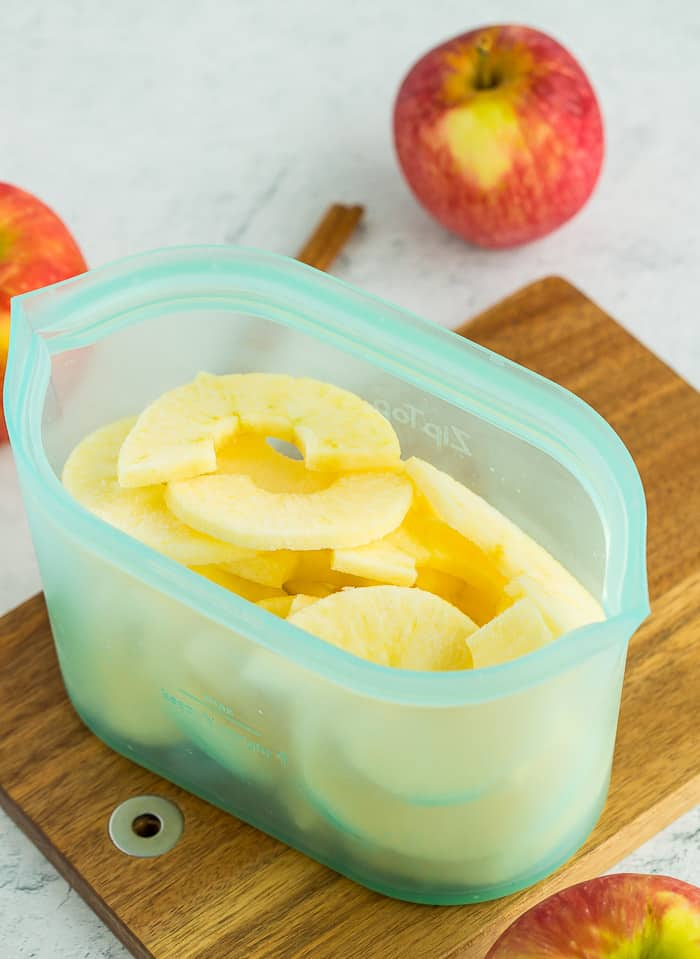 sliced frozen apples in a reusable silicone bag